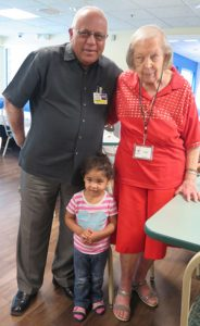 Chairman Ed Ameen with longtime volunteer Irene Copley & child