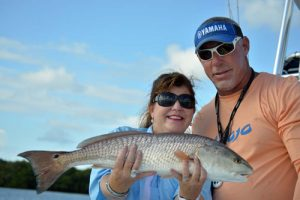Alison Barrick & Captain Mike Anderson with large redfish
