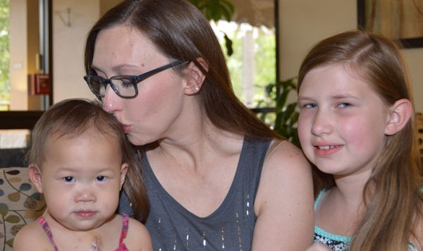 Melinda Loe with two daughters at RMH